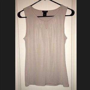 Sleeveless cream colored camisole
